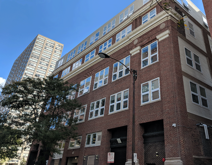 Vintage brick building with large garage doors in the South loop chicago