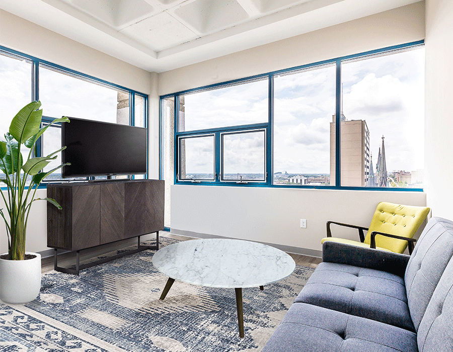 Milwaukee apartments with open living spaces and large bay windows overlooking the city.