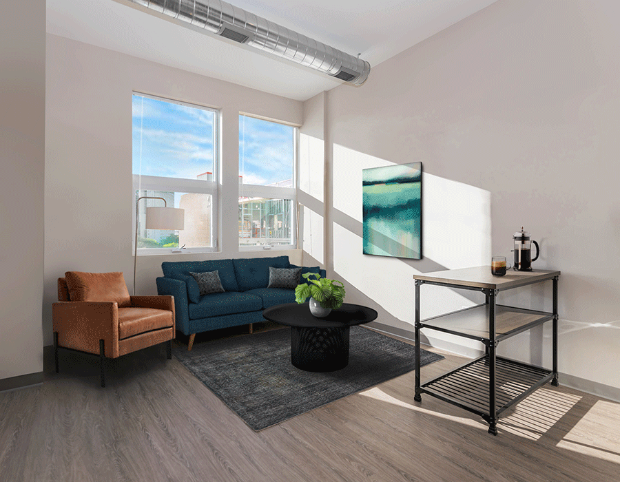 South loop apartment building featuring plank flooring, lofted ceilings, and city views