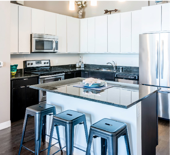luxury westown Milwaukee apartment kitchen with granite counters and stainless steel appliances